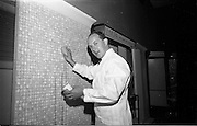 "23/06/1965<br /> 06/23/1965<br /> 23 June 1965<br /> I.C.I. (Imperial Chemical Industries) ""Vymura""  luxury wall covering (wallpaper?) demonstration at the Intercontinental Hotel, Dublin. They threw eggs at the speaker but Mr. Alistair Fulton, (Technical Representative of the Paints Division, I.C.I.) welcomed the chance to show how even eggs could be washed off the new Vymura wall covering."
