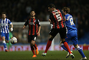 Craig Mackail-Smith, Brighton striker sand AFC Bournemouth defender Tommy Elphick during the Sky Bet Championship match between Brighton and Hove Albion and Bournemouth at the American Express Community Stadium, Brighton and Hove, England on 10 April 2015.
