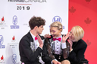 KELOWNA, BC - OCTOBER 25:  Canadian ice dancers Piper Gilles and Paul Poirier celebrate their scores for rhythm dance at Skate Canada International with their coach Megan Wing at Prospera Place on October 25, 2019 in Kelowna, Canada. (Photo by Marissa Baecker/Shoot the Breeze)