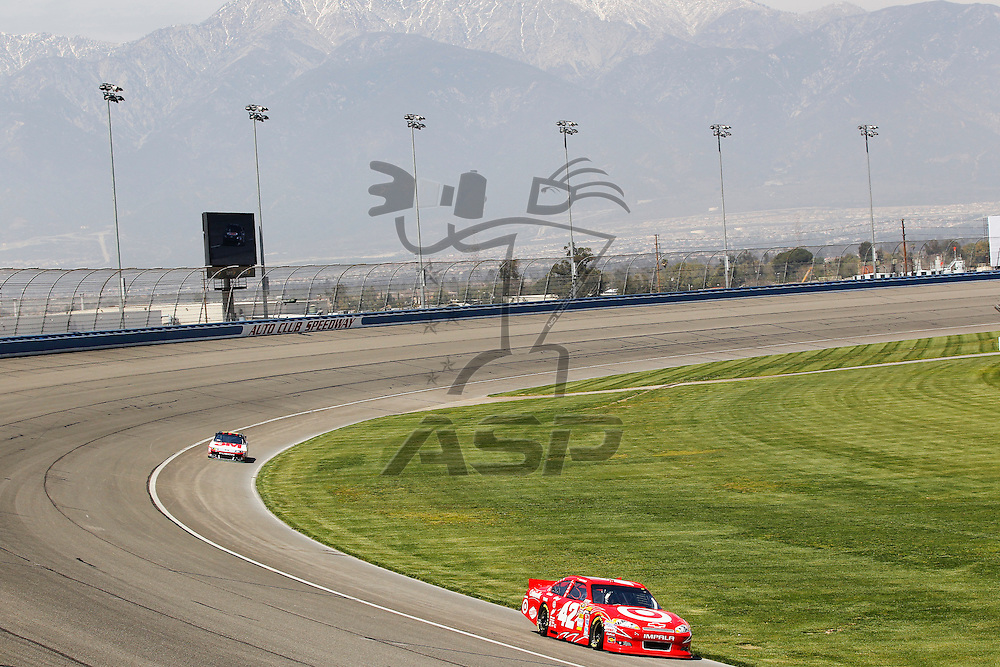 FONTANA, CA - MAR 23, 2012:  Juan Pablo Montoya (42)  and Greg Biffle (16) brings their cars through turn 4 during the Auto Club 400 at the Auto Club Speedway in Fontana, CA.