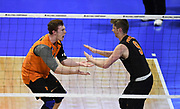 Princeton Tigers libero Corry Short (24) celebrates with outside hitter Greg Luck (9) against the Pepperdine Waves during an NCAA Championships opening round match, Wednesday, April 30, 2019, in Long Beach, Calif. Pepperdine defeated Princeton 25-23, 19-25, 25-16, 22-25, 15-8.