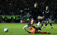 Photo: Paul Thomas/Sportsbeat Images.<br />Hibernian v Dundee United. Clydesdale Bank Premier League. 24/11/2007.<br /><br />Abdessalam Benjelloun of Hibs jumps the tackle of the Dundee defender Darren Dods.