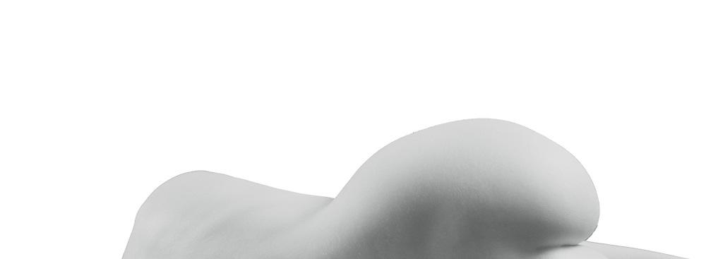 Nude female torso on black background