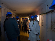 A group of visitors in a tunnel leading from the headquater underground to the Honecker Bunker.