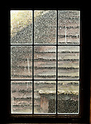 Old glass window panes with bubbles. The Hardanger Folk Museum was founded in 1911 in Utne, Norway.