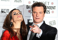 Livia Giuggioli; Colin Firth The Moet British Independent Film Awards, Old Billingsgate Market, London, UK, 05 December 2010:  Contact: Ian@Piqtured.com +44(0)791 626 2580 (Picture by Richard Goldschmidt)