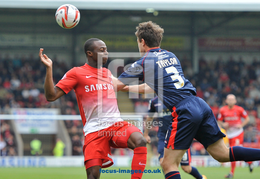 Picture by Alan Stanford/Focus Images Ltd +44 7915 056117<br />28/09/2013<br />Moses Odubajo of Leyton Orient and Andy Taylor of Walsall during the Sky Bet League 1 match at the Matchroom Stadium, London.