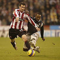 Photo: Aidan Ellis.<br /> Sheffield United v Manchester City. The Barclays Premiership. 26/12/2006.<br /> City's Darius Vassell (R) tackles Sheffield's  Keith Gillespie