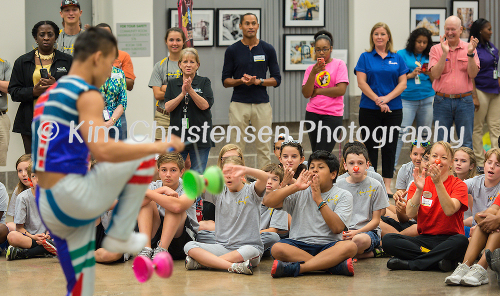 Members of the Ringling Brothers Circus entertain volunteers at the Houston Food Bank, July 15, 2015, in Houston, Texas.
