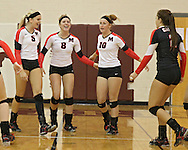 Maquoketa's Allison Vandemore (5), Aubree Taylor (8) Marlee Lindstrom (10), and Nicole Snyder (2) celebrate a score during the WaMaC Tournament Championship game at Mount Vernon High School in Mount Vernon on Thursday October 11, 2012. Solon defeated Maquoketa 17-25, 25-15, 15-10.
