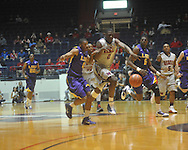 "Ole MIss forward Reginald Buckner (2)  and Louisiana State's Chris Bass (4) and Louisiana State's Malcolm White (5) chase the ball at the C.M. ""Tad"" Smith Coliseum in Oxford, Miss. on Wednesday, February 9, 2011. Ole Miss won 66-60 and is now 4-5 in the Southeastern Conference."