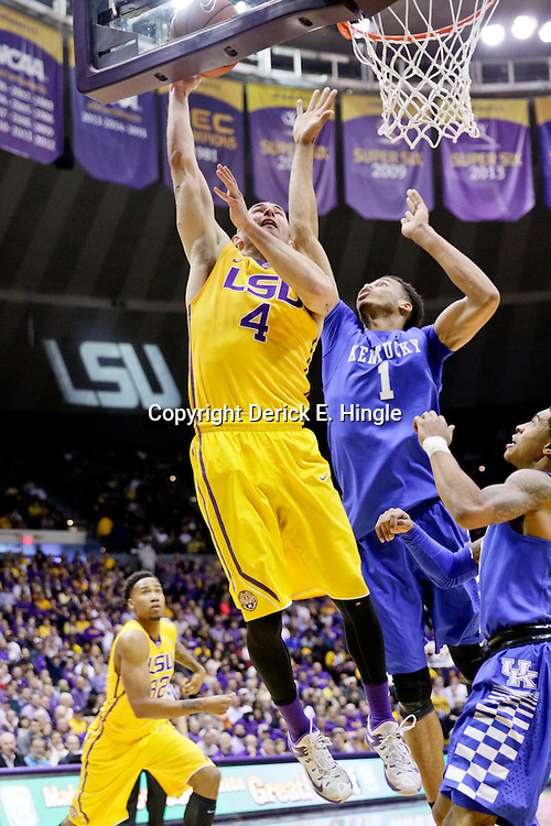 Jan 5, 2016; Baton Rouge, LA, USA; LSU Tigers guard Keith Hornsby (4) shoots over Kentucky Wildcats forward Skal Labissiere (1) during the first half of a game at the Pete Maravich Assembly Center. Mandatory Credit: Derick E. Hingle-USA TODAY Sports