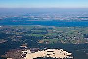 Nederland, Gelderland, Gemeente Nunspeet, 06-09-2010; noordelijk deel Gelderse Veluwe, gezien naar het Veluwemeer (onderdeel van de Randmeren). In de voorgrond Hulsthorsterheide en Hulsthorsterzand, de weg is de A28. De warme lucht boven de polder Flevoalnd laat inversie zien. .Northern Veluwe, seen to the 'border lakes' between the old and new land..luchtfoto (toeslag), aerial photo (additional fee required).foto/photo Siebe Swart