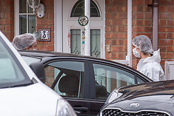 © Licensed to London News Pictures. 20/10/2019. Milton Keynes, UK. Forensic investigators stand outside a blood stained door as police investigate the double murder of two 17-year-old boys. Thames Valley Police and South Central Ambulance Service were called to a property in Archford Croft, Emerson Valley, Milton Keynes, just before midnight following reports of a stabbing having taken place. Two adult males have also been injured in the incident. Photo credit: Peter Manning/LNP