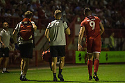 Ollie Palmer (Crawley Town)  leaving the pitch following his injury in a tackle with Ben Godfrey (Norwich)  & Ibrahim Amadou (Norwich) during the EFL Cup match between Crawley Town and Norwich City at The People's Pension Stadium, Crawley, England on 27 August 2019.