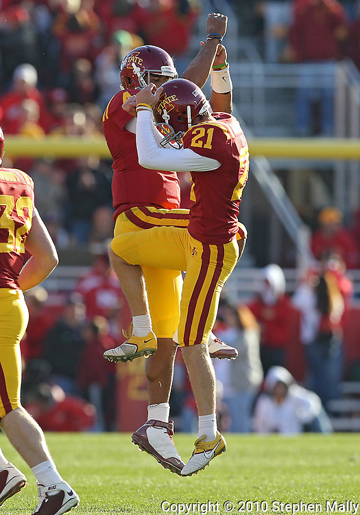 November 06 2010: Iowa State Cyclones kicker Grant Mahoney (21) is congratulated by Iowa State Cyclones quarterback Austen Arnaud (4)  after his 57 yard field goal during the first half of the NCAA football game between the Nebraska Cornhuskers and the Iowa State Cyclones at Jack Trice Stadium in Ames, Iowa on Saturday November 6, 2010. Nebraska defeated Iowa State 31-30.