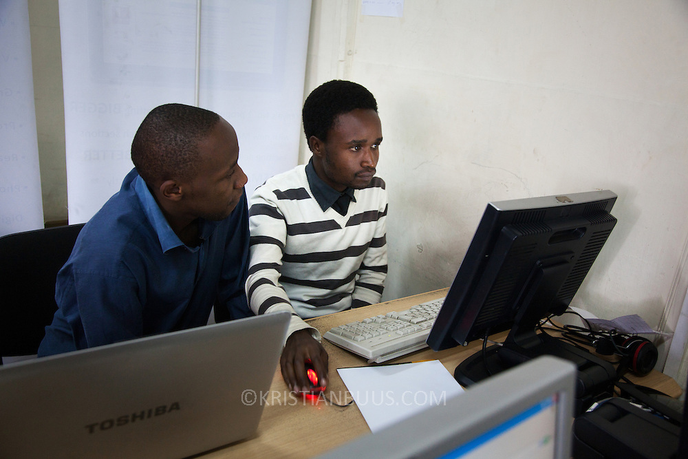 Robert Bolimo, 23, ( on the right )is a Nairobits graduate. He works as an intern at Jengo Web in down town Nairobi and he hopes to be able to stay on and  get a job at Jenga Web. Here he is with Esra Muriithi, one of Jenga Web's 4 directors. Robert came to Nairobi in 1992 and live alone in Mukuru slum. His family live 450 km out of Nairobi, Robert is their only hope for a better life and finaciel security..Nairobits is a charity teaching kids from Nairobi's slums IT and train them to get work in the IT sector.Every year 1mill young people graduate and leave school and only 1/3 have any hope of getting a job. Nairobits aim to train more than 500 young people / year from the slums, some with only basic formal education, how to set up their own business or get a job in the growing IT sector in Kenya. security.