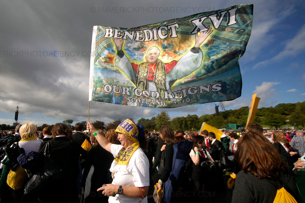 GLASGOW, UK - 16th September 2010: Pope Benedict XVI holds an open air mass at Bellahouston Park in Glasgow on the first day of his four day state visit to the UK...Picture shows a woman holding a flag of Pope Benedict XVI at Bellahouston Park...(Photograph: Richard Scott/MAVERICK)