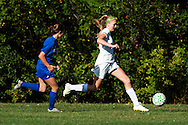 Rice's Saige Alpeter (3) runs past Milton's Kaleigh Goulette (4) with the ball during the girls soccer game between the Milton Yellowjackets and the Rice Green Knights at Rice Memorial High School on Saturday afternoon October 3, 2015 in South Burlington. (BRIAN JENKINS/ for the FREE PRESS)