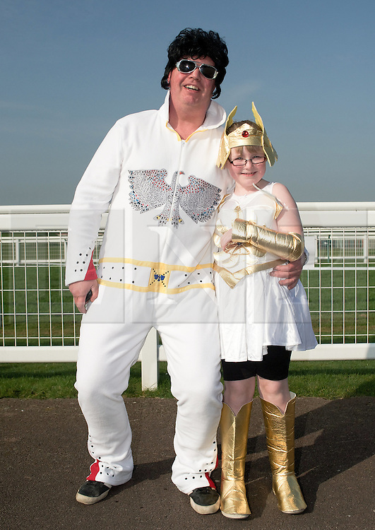 © Licensed to London News Pictures. 25/03/2012..Redcar racecourse, Redcar, cleveland..Charlotte Reidy, 8 and her Elvis impersonator dad, Peter get into the spirit of the sports relief mile at Redcar racecourse...Hundreds of people took part in the charity sports relief mile at the racecourse at Redcar in Cleveland to help raise money for the charity event. Participants had the choice of running either one, three or six miles...Photo credit : Ian Forsyth/LNP