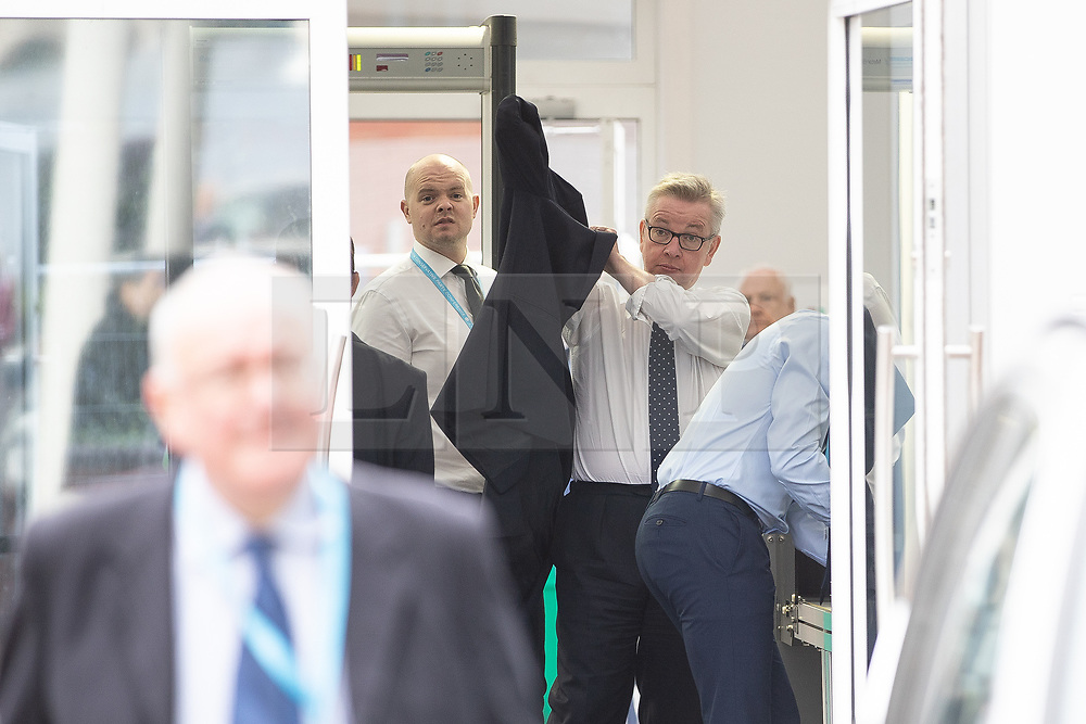 © Licensed to London News Pictures . 02/10/2018. Birmingham, UK. MICHAEL GOVE arrives and passes through security at the conference on day 3 of the Conservative Party conference at the ICC in Birmingham . Photo credit: Joel Goodman/LNP
