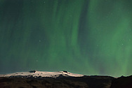 After seeing only about 1 hour of clear skies over 5 nights, I was determined to catch a good aurora display on my last night in Iceland. The southern coast was showing the best weather forecast. So that is where I went, camping in the shadow of the glacier-capped Eyjafjallajökull volcano which was lit up by the moonlight. This is the same volcano that erupted 7 years ago with the giant ash cloud causing the biggest disruption to air travel since WWII. As soon as it got dark the northern lights came out and stayed the entire night. Compared to lower latitudes, the aurora up here is brighter and moves and changes so much faster. It will often appear anywhere in the sky, not just limited to the north.