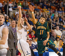Parkersburg South guard Ty Dobson (0) shoots a three over Huntington guard Tavian Dunn-Martin (11) during the Class AAA championship game at the Charleston Civic Center.