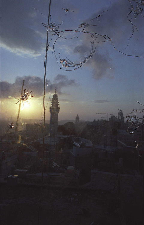 Photo: Nadav Neuhaus.Beit Lehem, Palestine..Beit Lehem, through a window that palestinians shot at.