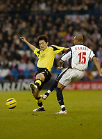 Photo: Leigh Quinnell.<br /> West Bromwich Albion v Manchester City. The Barclays Premiership. 10/12/2005. Man Citys Jihai Sun flys into West Broms Diomansy Kamara.