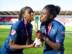 LLANELLI, WALES - Saturday, August 31, 2013: France's Aissatou Tounkara [l] and Griedge M'Bock Bathy [r] celebrate with the trophy after beating England during the Final of the UEFA Women's Under-19 Championship Wales 2013 tournament at Parc y Scarlets. (Pic by David Rawcliffe/Propaganda)