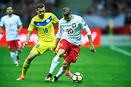 Warsaw, Poland - 2017 September 04: (R) Lukasz Piszczek from Poland fights for the ball with (L) Dmitri Shomko from Kazakhstan during soccer match Poland v Kazakhstan - FIFA 2018 World Cup Qualifier at PGE National Stadium on September 04, 2017 in Warsaw, Poland.<br /> <br /> Adam Nurkiewicz declares that he has no rights to the image of people at the photographs of his authorship.<br /> <br /> Picture also available in RAW (NEF) or TIFF format on special request.<br /> <br /> Any editorial, commercial or promotional use requires written permission from the author of image.<br /> <br /> Mandatory credit:<br /> Photo by © Adam Nurkiewicz / Mediasport
