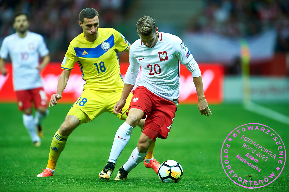 Warsaw, Poland - 2017 September 04: (R) Lukasz Piszczek from Poland fights for the ball with (L) Dmitri Shomko from Kazakhstan during soccer match Poland v Kazakhstan - FIFA 2018 World Cup Qualifier at PGE National Stadium on September 04, 2017 in Warsaw, Poland.<br /> <br /> Adam Nurkiewicz declares that he has no rights to the image of people at the photographs of his authorship.<br /> <br /> Picture also available in RAW (NEF) or TIFF format on special request.<br /> <br /> Any editorial, commercial or promotional use requires written permission from the author of image.<br /> <br /> Mandatory credit:<br /> Photo by &copy; Adam Nurkiewicz / Mediasport