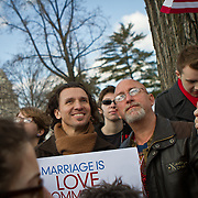 Giovanni Miranda, left and his partner Todd Fernandez, who led a prayer service earlier in the morning traveled from New York City to  demonstrate outside the Supreme Court during the hearings on California's ballot proposition 8, which recognized marriage only between a man and woman.  March 26, 2013.