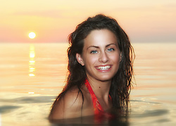 Pretty brunette girl in bikini having fun at the beach People People People