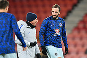 Chelsea assistant manager Gianfranco Zola Gonzalo shares a joke with Higuain (9) of Chelsea during the warm up before the Premier League match between Bournemouth and Chelsea at the Vitality Stadium, Bournemouth, England on 30 January 2019.