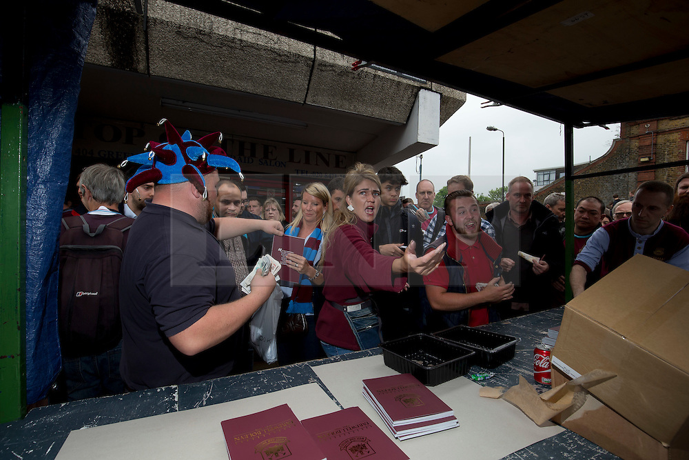 &copy; Licensed to London News Pictures. 10/05/2016. LONDON, UK. <br /> West Ham United Program sellers selling out of the final program to be produced for the clubs last game at the Boleyn Ground against Manchester United. Photo credit: LNP