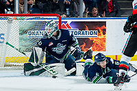 KELOWNA, BC - MARCH 6: Tyrel Bauer #6 tries to block a shot as Blake Lyda #40 of the Seattle Thunderbirds defends the net against the Kelowna Rockets at Prospera Place on March 6, 2020 in Kelowna, Canada. (Photo by Marissa Baecker/Shoot the Breeze)