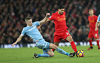 Football - 2016 / 2017 Premier League - Liverpool vs. Stoke City<br /> <br /> Emre Can of Liverpool and Ryan Shawcross of Stoke City during the match at Anfield.<br /> <br /> COLORSPORT/LYNNE CAMERON