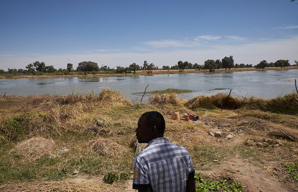 A man looks out across the Komadougou river  in Diffa, Niger on February 17, 2016. The river marks the border between Niger and Nigeria. With the army of Nigeria abandoning this northern border, Boko Haram launch attacks on civilians and the military by crossing the river and then retreating back into the territory it controls in Nigeria.