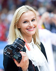 Woman with a camera at the Eurobasket 2009, on September 20, 2009, in Arena Spodek, Katowice, Poland.  Spain won, Serbia placed second, Greece third and Slovenia fourth. (Photo by Vid Ponikvar / Sportida)