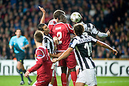 23.10.12. Copenhagen, Denmark. UEFA Champions League Group E, FC Nordsjaelland  1 vs Juventus 1 at the Parken Stadium. Okore (C) of FC Nordsjaelland fights for the ball during the UEFA Champions League. Photo: © Ricardo Ramirez..