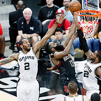 01 May 2017: Houston Rockets guard James Harden (13) goes for the layup past San Antonio Spurs forward Kawhi Leonard (2) and San Antonio Spurs forward LaMarcus Aldridge (12) during the Houston Rockets 126-99 victory over the San Antonio Spurs, in game 1 of the Western Conference Semi Finals, at the AT&T Center, San Antonio, Texas, USA.