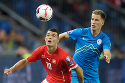 05.09.2015, St. Jakob Park, Basel, SUI, UEFA Euro 2016 Qualifikation, Schweiz vs Slowenien, Gruppe E, im Bild Granit Xhaka (SUI) gegen Valter Birsa (SLO) // during the UEFA EURO 2016 qualifier group E match between Switzerland and Slovenia at the St. Jakob Park in Basel, Switzerland on 2015/09/05. EXPA Pictures © 2015, PhotoCredit: EXPA/ Freshfocus/ Steffen Schmidt<br /> <br /> *****ATTENTION - for AUT, SLO, CRO, SRB, BIH, MAZ only*****