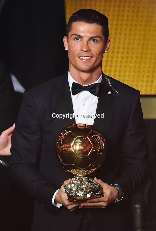 12.01.2015. Zurich, Switzerland. FIFA Ballon d'Or Gala 2014 held at the Kongresshaus in Zurich, Switzerland.  Cristiano Ronaldo with his trophy FIFA Ballon d Or 2014