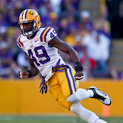 November 17, 2012; Baton Rouge, LA, USA  LSU Tigers defensive end Barkevious Mingo (49) against the Ole Miss Rebels during a game at Tiger Stadium. LSU defeated Ole Miss 41-35. Mandatory Credit: Derick E. Hingle-US PRESSWIRE