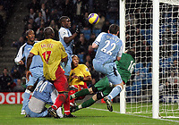 Photo: Paul Thomas.<br /> Manchester City v Watford. The Barclays Premiership. 04/12/2006.<br /> <br /> Micah Richards (C) and Richard Dunne (22) of Man City have great chances to score only to be denined by Richard Lee (Green), keeper of Watford.