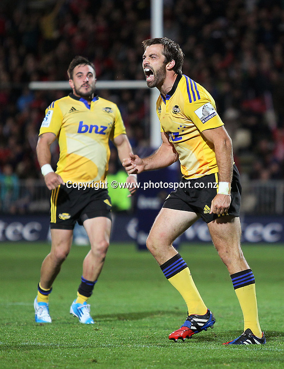 Conrad Smith of the Hurricanes celebrates the final whistle with Andre Taylor following the Investec Super Rugby match between Crusaders v Hurricanes at AMI Stadium, Christchurch. 28 March 2014 Photo: Joseph Johnson/www.photosport.co.nz