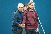 Francesco Molinari of Italy (left) and Tommy Fleetwood of England shake hands at the end of their round during the British Masters 2018 at Walton Heath Golf Course, Walton On the Hill, Surrey  on 11 October 2018. Picture by Martin Cole.