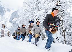 THEMENBILD - der Melcher Manuel Lerch mit seinen Burschen stapfen durch den Schnee. In Krimml hat sich der Brauch des Alperns erhalten, den man anderswo kaum noch kennt. Am Wochenende um Martini ziehen Buben mit Kuhglocken von Haus zu Haus. Das laute Läuten soll böse Geister vertreiben. Die Alperer sind zwischen acht und 14 Jahren alt. Sie besuchen dabei rund 150 Haushalte, aufgenommen am 12. November 2016, Krimml, Österreich // In Krimml, the tradition of Alpern have been preserved, which are hardly known elsewhere. At the weekend around Martini, boys with cowbells move from house to house. The loud ringing is to drive out evil spirits. The Alperers are between eight and 14 years old. They visit about 150 households, Krimml, Austria on 2016/11/12. EXPA Pictures © 2016, PhotoCredit: EXPA/ JFK