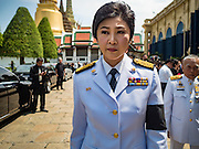 14 OCTOBER 2016 - BANGKOK, THAILAND: YINGLUCK SHINAWATRA, the former Prime Minister of Thailand, leaves the Sahathai Samakom Pavilion at the Grand Palace after paying respects to Bhumibol Adulyadej, the King of Thailand, who died Oct. 13, 2016. Yingluck's government was overthrown by a military coup in 2014. He was 88. His death comes after a period of failing health. With the king's death, the world's longest-reigning monarch is Queen Elizabeth II, who ascended to the British throne in 1952. Bhumibol Adulyadej, was born in Cambridge, MA, on 5 December 1927. He was the ninth monarch of Thailand from the Chakri Dynasty and is known as Rama IX. He became King on June 9, 1946 and served as King of Thailand for 70 years, 126 days. He was, at the time of his death, the world's longest-serving head of state and the longest-reigning monarch in Thai history.     PHOTO BY JACK KURTZ